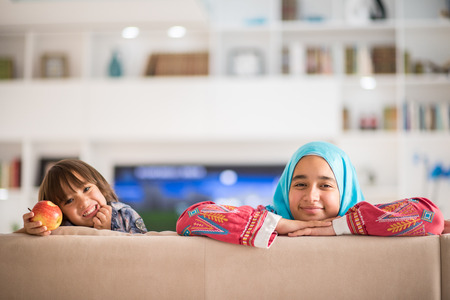 turkish woman: Young woman with little kid at home