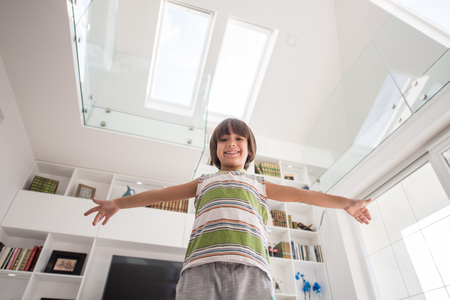 one room school house: Happy kid at home with hands up