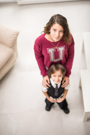 sitter: Girl and little cute boy Stock Photo