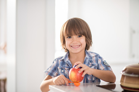 Cute adorable little boy in the kitchen Stock Photo