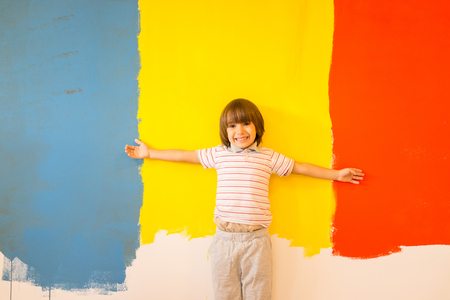 Kids in painting room on wall