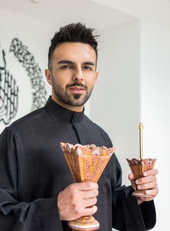parfume: Arabian man with traditional parfume