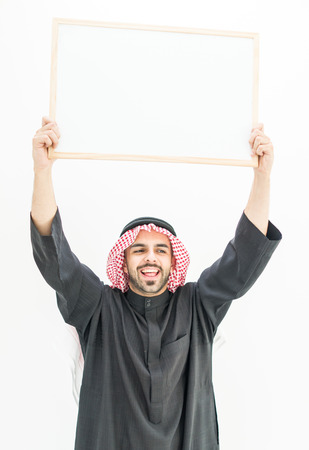 message board: Attractive Arabic young man with white board for your message or text