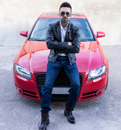 sportcar: Young confident man with a sport car