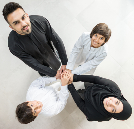 Happy Arabic Muslim family at modern home having fun and good time together photo