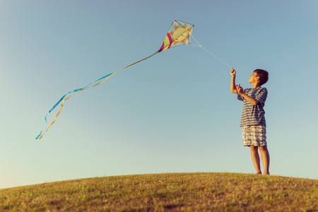 teen golf: Running with kite on summer holiday vacation, perfect meadow and sky on seaside
