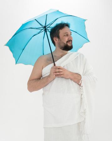 Hajj pilgrim with umbrella