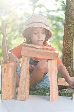 Boy playing with wood