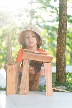 Boy playing with wood Stock Photo