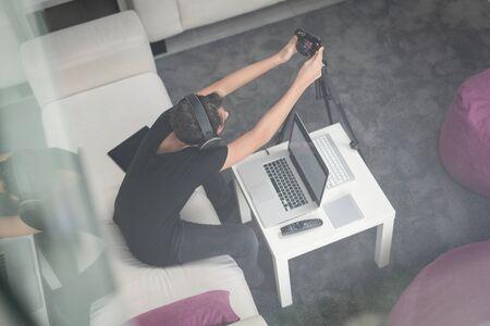 Top view of teenage boy vlogging