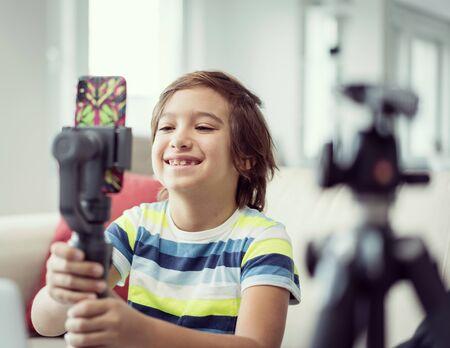 Little boy recording video content