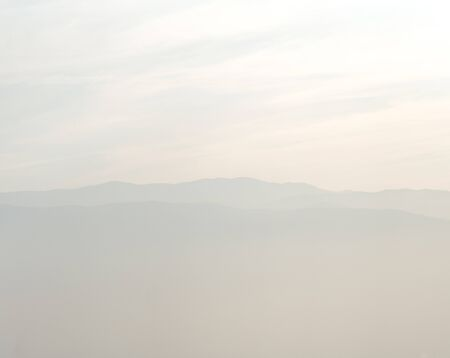Misty mountains with sky horizon