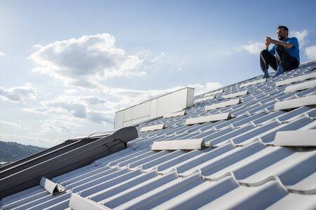 man on roof Stock Photo