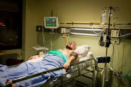 Man on hospital bed for recovery , high photo