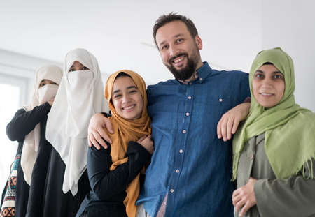 Muslim man with 4 wives portrait ,quality photo
