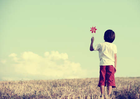 Kid standing in the nature with large copy space