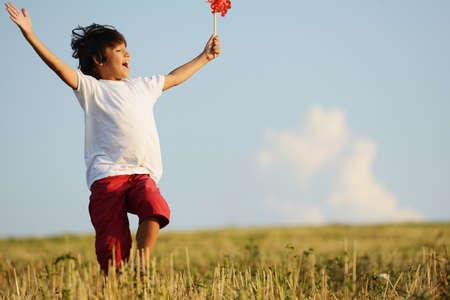 Happy kid running on beautiful field