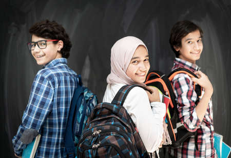 Group of multy ethnic kids in classroom space Stock Photo
