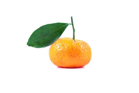 One small chinese orange with leaf on white background photo