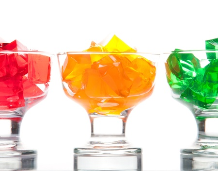 GELATIN: Three colored jelly isolated on white
