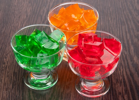 Three colored jelly on a wooden board Stock Photo - 12270599