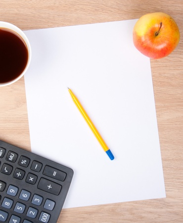 pen on a white sheet of paper with apple, coffee and calculator Stock Photo - 12270807