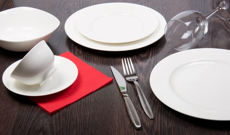 porcelain plate on a dinner table  Stock Photo