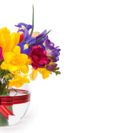 Beautiful spring flowers in glass  photo