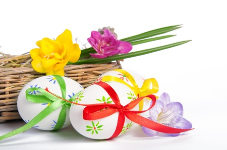 Colorful Easter wggs with a bow in a basket photo