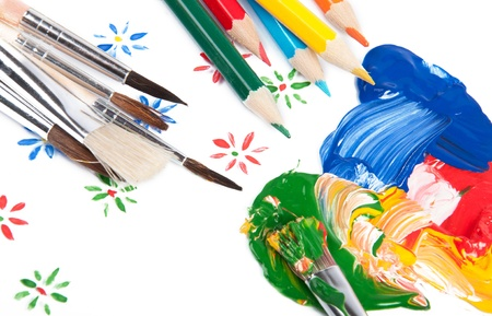 Set of brushes with colorful paint photo
