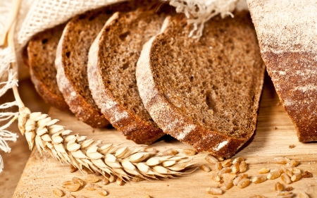 Fresh baked traditional bread and wheat photo