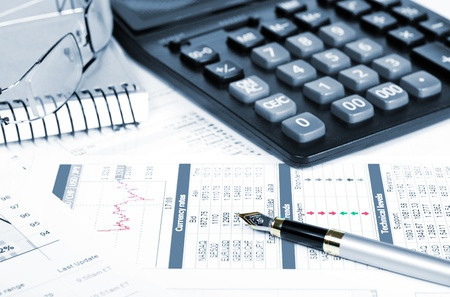 Business of financial analitics desktop with accountiarts and diagrams