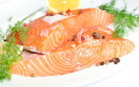 Fresh salmon red fish with lemon and spices photo