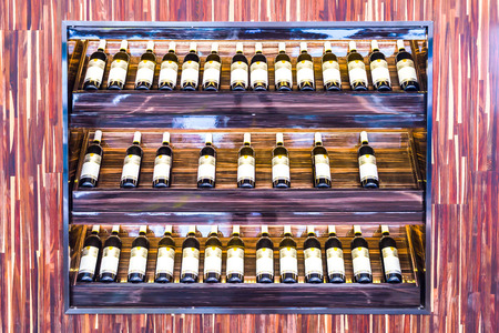 intoxicant: wine bottles stacked on wooden racks