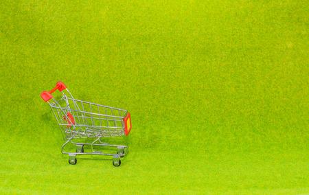 kart: shopping kart on green background Stock Photo