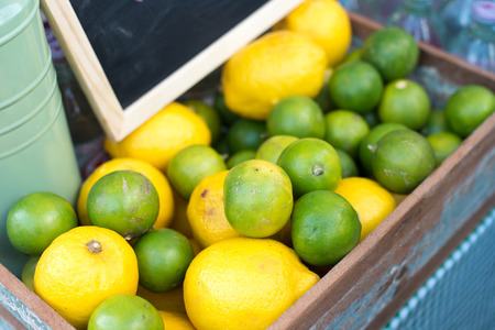 stacked up: lemons and limes stacked up for sale on a market