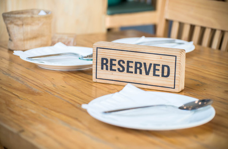 reserved sign: Reserved sign on a table in restaurant Stock Photo