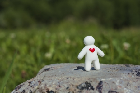 heart of stone: Toy man with a blurred background Stock Photo
