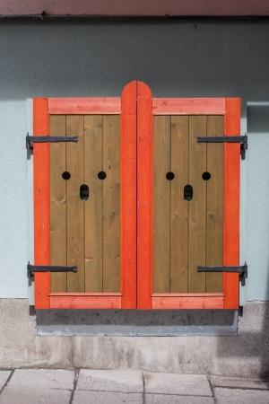 elegant wooden window shutters closed photo