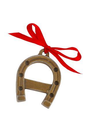 A ferro di cavallo con un nastro rosso - simbolo della felicità Archivio Fotografico - 6389687