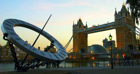 sun dial: Tower Bridge and sun dial at dusk