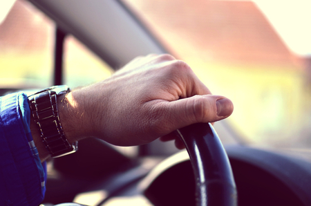 Driver hands holding steering wheel photo