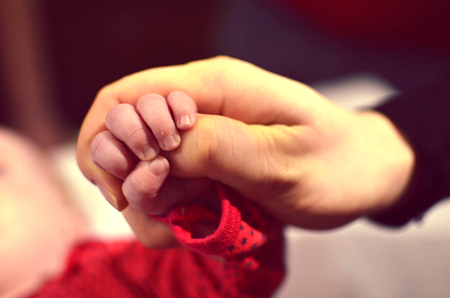 nursling: Mothers hand holding daughters hand