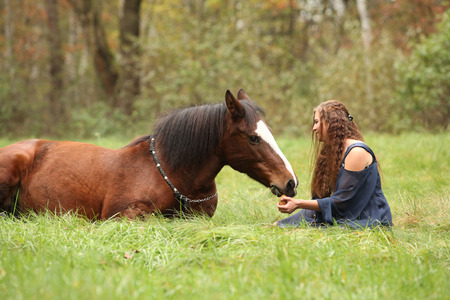 Amazing couple showing natural horsemanship in freedom