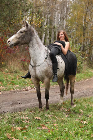 appaloosa: Amazing girl with long hair riding a horse without bridle