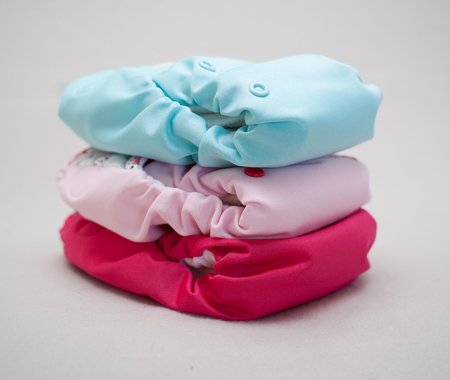 Stack of eco cloth diapers different colors