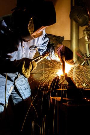 Welder at work welding steel structures in the workshop in production Reklamní fotografie