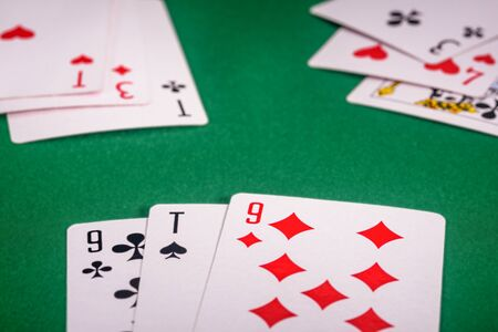 playing cards on a green table close-up Stock Photo