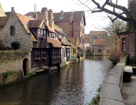 Shot of historic medieval buildings along a canal in Bruges, Belgium