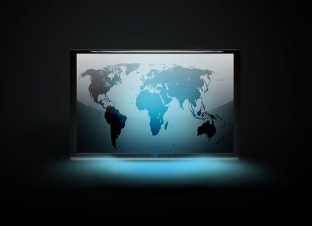 monitor with a world map on a dark background photo